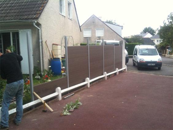 Pose de clôture en palissades bois